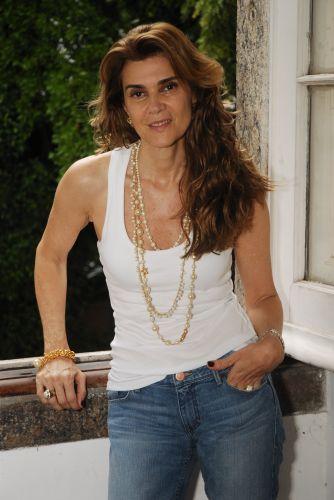 Célia (Mônica Torres)