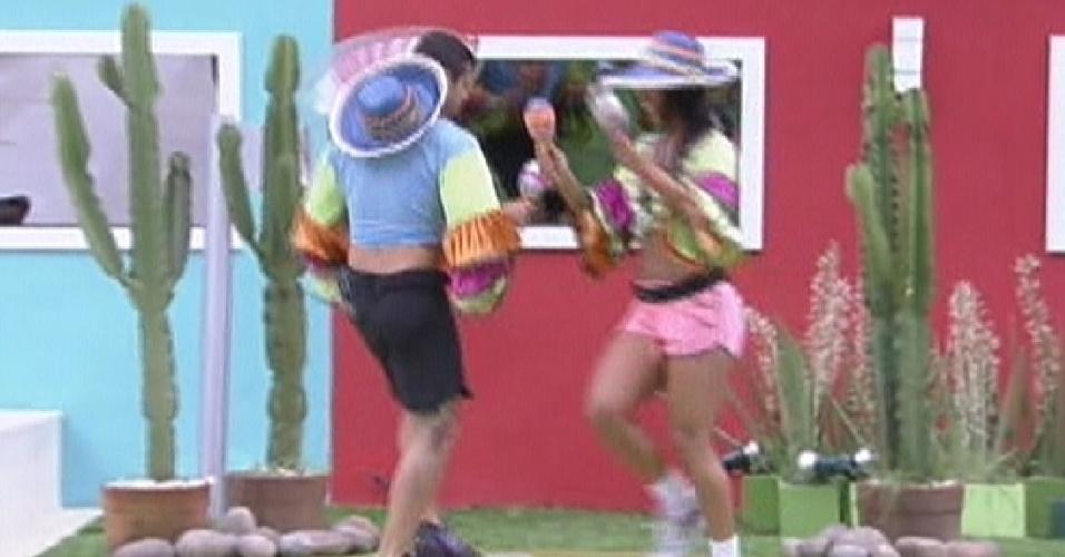 Escolhidos para pagarem o castigo do monstro, Yuri e Kelly dançam  vestidos de mariachis (27/1/12)