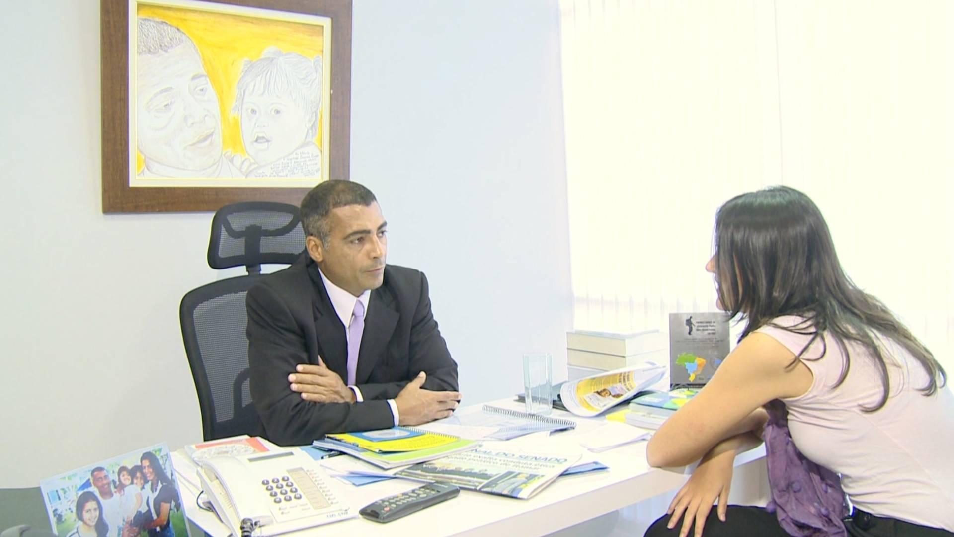 Romário e a repórter Lia Kunzler